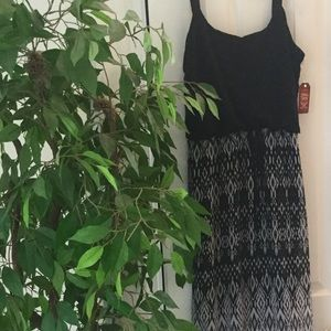 Black maxi dress with sheer print skirt